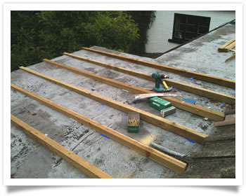 Work to a flat roof at a house in Edwalton