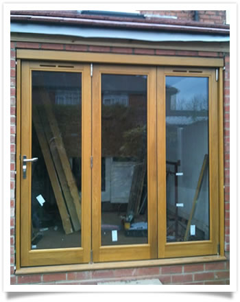 New bi-fold solid wood French window in Lady Bay