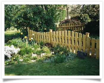 Custom design garden fence surrounding a pond in Wilford